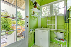 Charming green garden mud room with glass door. Royalty Free Stock Photos