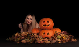 Charming halloween witch with funny pumpkins Royalty Free Stock Image
