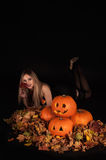 Charming halloween witch with funny pumpkins Stock Images