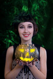 Charming halloween witch over black background. Royalty Free Stock Images