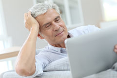 Charming handsome senior man with tablet Stock Photos
