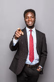 Charming handsome young black business man pointing his hand up to show present sell product isolated Royalty Free Stock Image
