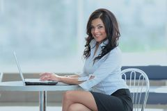 Charming businesswoman in the lobby of the business center Stock Image