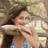 Charming happy woman near the branches Stock Images