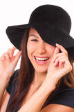 Charming and happy young woman in a black hat Royalty Free Stock Image