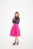 Charming happy young woman in bright pink skirt Royalty Free Stock Image