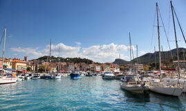 The charming harbor of Cassis in the French Riviera. Sunny harbor of Cassis filled with boats in the French Riviera royalty free stock photography