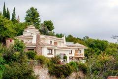 Charming hillside house Stock Images