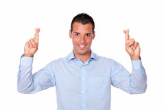 Charming hispanic guy with luck sign Royalty Free Stock Photos