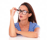 Charming hispanic holding glasses looking at you Royalty Free Stock Photo