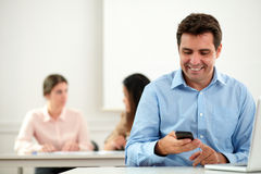 Charming hispanic male reading a message Royalty Free Stock Photography