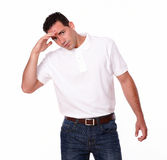 Charming hispanic man standing with headache Stock Images