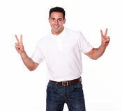 Charming hispanic man with victory fingers Stock Photography