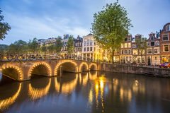 Charming houses by the canal in Amsterdam Royalty Free Stock Photography