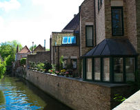 Charming houses on Canals in old Bruges, Belgium Royalty Free Stock Photo
