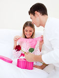 Charming husband giving a present to his wife Stock Photo