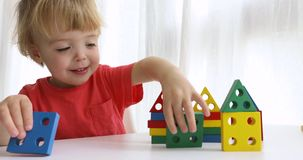 Little boy playing with colorful block stock footage