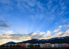 Charming Innsbruck architectural houses on Inn River and European alps natural background, Tyrol, Austria, Europe Royalty Free Stock Image