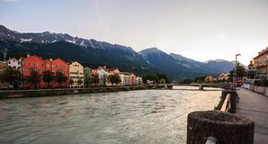 Charming Innsbruck architectural houses on Inn River and European alps natural background, Tyrol, Austria, Europe Stock Photos