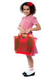 Charming kid carrying school stationery Stock Photos
