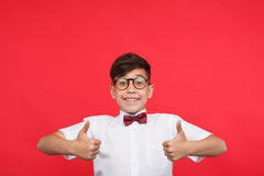Charming kid holding thumbs up Royalty Free Stock Image
