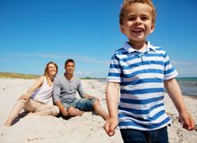 Charming Kid with Mom and Dad on Vacation Stock Image