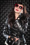 Charming lady in black leather jacket stock image