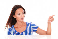 Charming lady in blue t-shirt gesturing selecting Stock Photo
