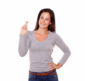 Charming lady crossing fingers looking at you Royalty Free Stock Photo