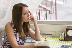 Charming lady deep in thoughts stock photo