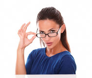 Charming lady with glasses looking at you Royalty Free Stock Image