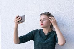 Charming lady having fun with device stock photos