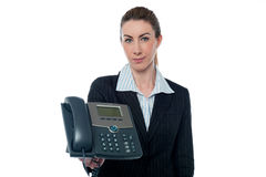 Charming lady holding telephone Stock Images