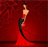 Charming lady in a red dress Royalty Free Stock Photos