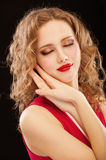 Charming lady in red evening dress Stock Image