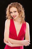 Charming lady in red evening dress Stock Images
