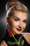Charming lady with red rose Stock Images