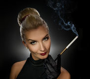 Charming lady smoking cigarette Stock Images