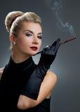 Charming lady smoking cigarette Stock Image