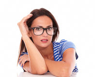 Charming lady with spectacles looking at you Royalty Free Stock Photography