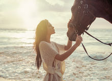 Charming lady stroking her beloved horse friend. Charming woman stroking her beloved horse friend Stock Photos