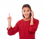 Charming lady talking on her phone while smiling Royalty Free Stock Photos
