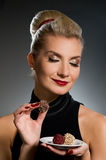 Charming lady tasting chocolate Royalty Free Stock Photography