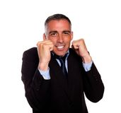 Charming latin businessman boxing Stock Photo