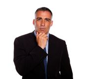 Charming latin businessman thinking Royalty Free Stock Photography