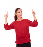 Charming latin female pointing up her fingers Royalty Free Stock Photos
