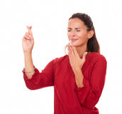Charming latin female with wishing sign Stock Photography