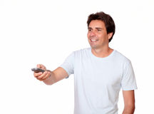 Charming latin guy holding remote control Royalty Free Stock Photography