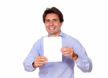 Charming latin male holding a blank card Stock Photo