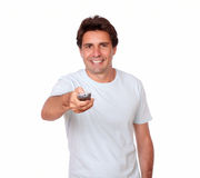 Charming latin man holding remote control Stock Images